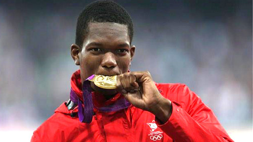 Photo: Trinidad and Tobago javelin thrower Keshorn Walcott plays with his gold medal at the London 2012 Olympic Games.
