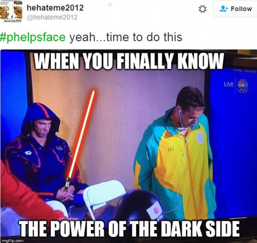 Photo: Muahahahaha! Okay seriously, can somebody give Michael Phelps a hug?