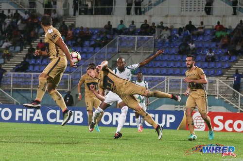 Photo: Pumas UNAM player Jose Antonio Garcia (centre) heads clear from W Connection attacker Jamal Charles during CONCACAF Champions League action in Couva on 3 August 2016. Pumas won 4-2. (Courtesy Chevaughn Christopher/Wired868)