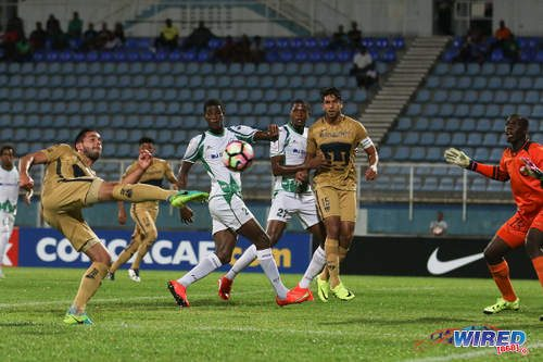 Photo: A Pumas UNAM attacker (left) fires towards goal while his teammate Eduardo Herrera (centre) and W Connection players (from left) Kurt Frederick, Jelani Peters and Julani Archibald look on during CONCACAF Champions League action in Couva on 3 August 2016. Pumas won 4-2. (Courtesy Chevaughn Christopher/Wired868)