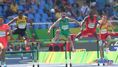 Photo: Trinidad and Tobago's Jehue Gordon (second from right) challenges competitors (from left) Keisuke Nozawa (Japan), Jaheel Hyde (Jamaica), Thomas Barr (Ireland) and Sergio Fernandez in the 400 metre hurdle heats at the Rio 2016 Olympics on 15 August 2016. (Copyright Sean Morrison/Wired868)