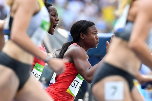 Photo: Trinidad and Tobago's Khalifa St Fort (right) grabs the baton from teammate Kelly Ann Baptiste in the Women's 4 x 100m Relay Round 1 at the Rio 2016 Olympic Games on 18 August 2016. (Copyright Jewel Samad/AFP 2016)