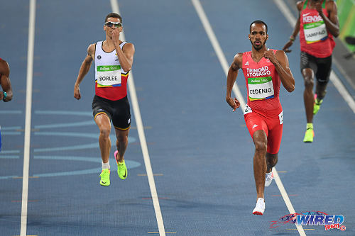 Photo: Trinidad and Tobago's Machel Cedenio (centre) cruises to victory in the first round of the 400 metre event at the Rio 2016 Olympics on 13 August. (Courtesy: Sean Morrison/Wired868)