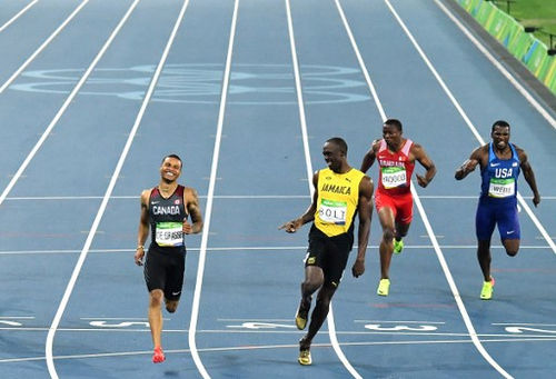 Photo: A laughing matter? Jamaica's Usain Bolt (second from left) laughs with Canada's Andre De Grasse (left) during the Men's 200m Semifinal at the Rio 2016 Olympic Games on 17 August 2016. (Copyright Jewel Samad/AFP 2016/Wired868)