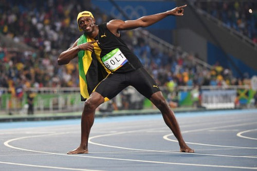 Photo: Jamaica's Usain Bolt celebrates after the Men's 100m Final at the Rio 2016 Olympic Games on 14 August 2016.  (Copyright Olivier Morin/AFP 2016/Wired868)
