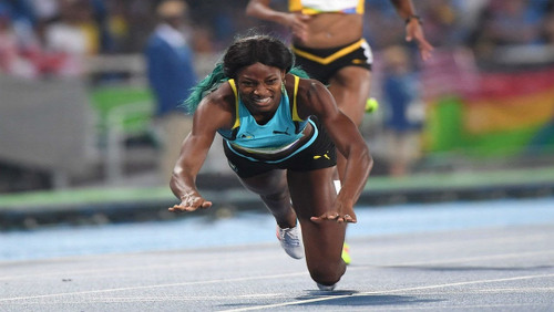 Photo: Bahamas athlete Shaunae Miller dives to the finish line during the 400 metre race at the Rio 2016 Olympic Games on 16 August 2016.