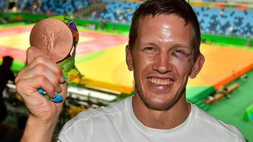 Photo: Well, you should see the other guy! No, seriously. If you see him, contact the Rio de Janeiro police. Judo bronze medalist Dirk Van Tichelt wants his cell phone back.