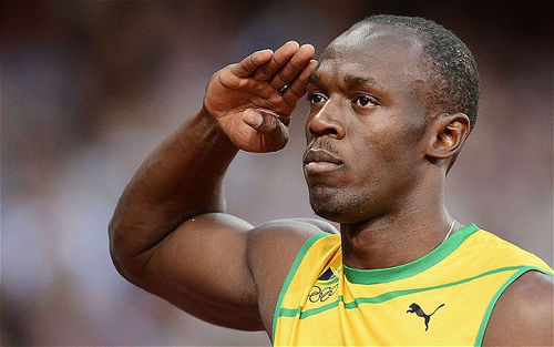 Photo: Jamaica sprint sensation Usain Bolt salutes the crowd. (Copyright UK Telegraph)