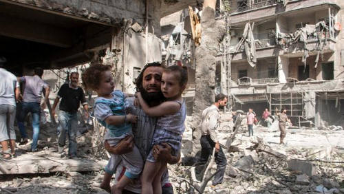 Photo: A family run for cover during a bombing in Syria. (Copyright Nehandradio.com)