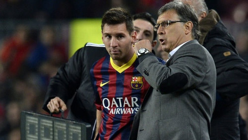 "Photo: Then Barcelona coach Gerald ""Tata"" Martino (right) passes on instructions to five time World Player of the Year Lionel Messi. (Copyright EPA)"