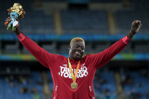 Photo: Trinidad and Tobago's Akeem Stewart celebrates his gold medal performance in the javelin event at the Rio 2016 Paralympic Games on 9 September 2016. (Copyright Alexandre Loureiro/Getty Images)