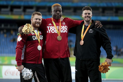 Photo: Trinidad and Tobago's javelin gold medalist Akeem Stewart (centre) shares the podium with Canada's Alister McQueen (left) and New Zealand's Rory McSweeny during the Rio 2016 Paralympic Games on 9 September 2016. (Copyright Alexandre Loureiro/Getty Images)