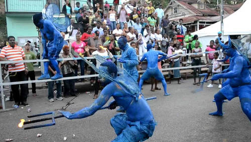 Photo: Blue Devils prance during the 2013 Carnival season.