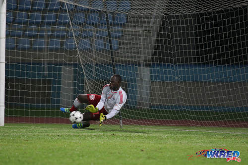Photo: Central FC goalkeeper Jan-Michael Williams saves a penalty from Defence Force captain Jerwyn Balthazar during the Digicel Charity Shield on 10 September 2016. Williams saved three penalties as Central won 3-1 from kicks from the penalty mark after a 2-2 regulation time draw. (Courtesy Chevaughn Christopher/Wired868)
