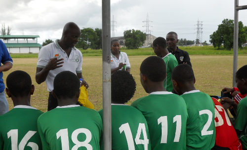 Photo: W Connection youth team Leonson Lewis (top left) talks to his players at a training session. (Courtesy Leonson Lewis)