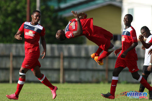 Photo: Fyzabad Secondary captain Sharkeel Louison (centre) celebrates his goal against St Anthony's College with a somersault in SSFL Premier Division action on 24 September 2016 at Fyzabad. (Courtesy Chevaughn Christopher/Wired868)