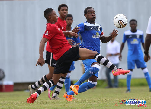 Photo: Fyzabad Secondary midfielder and captain Sharkeel Louison (right) in action against Pleasantville Secondary during SSFL Premier Division action at the Mahaica Oval on 17 September 2016. (Courtesy Sean Morrison/Wired868)