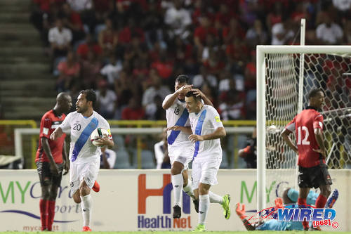 Photo: Guatemala captain Carlos Ruiz (second from left) and his teammates celebrate one of his two goals against Trinidad and Tobago at the Hasely Crawford Stadium in Port of Spain on Friday 2 September 2016. (Courtesy Allan V Crane/Wired868)