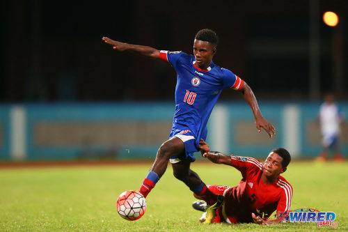 Photo: Haiti star Steeve Saint Doc (left) leaves a Cuba opponent for dead during the CFU Under-17 final on 25 September 2016 at the Ato Boldon Stadium in Couva. Haiti won 5-0. (Courtesy Allan V Crane/Wired868)