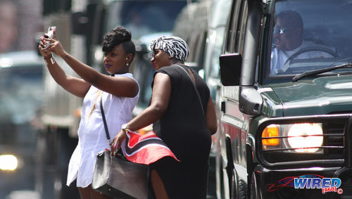 Photo: Two spectators take a selfie during Trinidad and Tobago's 2016 Independence Day Parade celebrations. (Courtesy Chevaughn Christopher/Wired868)