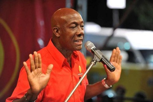 Photo: Prime Minister Dr Keith Rowley gestures on the election campaign platform. Is he saying that he did nothing wrong? (Courtesy Caribbean News Service)