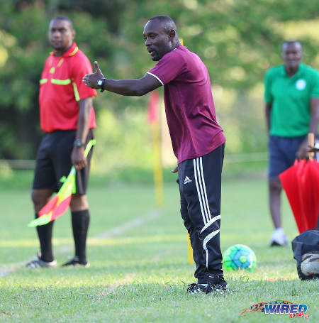 Photo: East Mucurapo Secondary coach Dale Saunders (centre) gives instructions during SSFL Premier Division action against Signal Hill at Moka on 14 September 2016. Signal Hill won 2-1. (Courtesy Sean Morrison/Wired868)