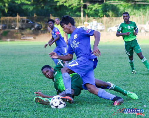Photo: Naparima College attacker Mark Ramdeen (centre) dribbles past a Trinity College Moka opponent during SSFL Premier Division action on 21 September 2016 at Moka. (Courtesy Sean Morrison/Wired868)