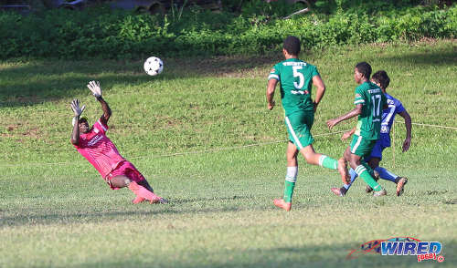 Photo: Trinity College Moka goalkeeper Desean Bowen (far left) tries in vain to save a chipped effort from Naparima College attacker Mark Ramdeen (far left) while his defenders (second from left) Isaiah Alexander and Raheem Jawahir look on during SSFL Premier Division action on 21 September 2016 at Moka. (Courtesy Sean Morrison/Wired868)