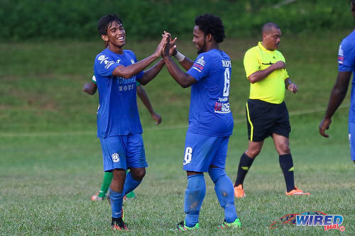 Photo: Naparima College goal scorer Mark Ramdeen (left) is congratulated by midfielder Judah St Louis during SSFL Premier Division action against Trinity College Moka on 21 September 2016 at Moka. (Courtesy Sean Morrison/Wired868)