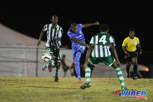 Photo: Naparima College midfielder Renaldo Francois (centre) goes for goal during SSFL Premier Division action against San Juan North at Irwin Park, Siparia on 7 September 2016. Both teams played to a 2-2 draw. (Courtesy Chevaughn Christopher/Wired868)