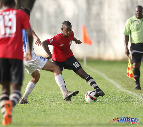 Photo: Pleasantville Secondary left back Nevorne Mc Nicholls (right) tries to dribble past an opponent during SSFL Premier Division action against St Mary's College at Serpentine Road on 10 September 2016. (Courtesy Sean Morrison/Wired868)