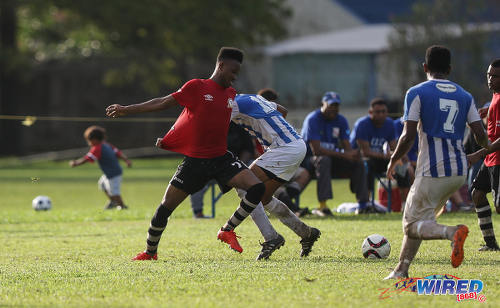Photo: Pleasantville Secondary midfielder Anfernee Joefield (left) holds off St Mary's College midfielder Joshua Joseph (centre) during SSFL Premier Division action at Serpentine Road on 10 September 2016. (Courtesy Sean Morrison/Wired868)