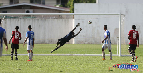 Photo: Pleasantville goalkeeper Raheem Lee (centre) dives in vain at a super volley from St Mary's College captain Matthaeus Granger during SSFL Premier Division action at Serpentine Road on 10 September 2016. (Courtesy Sean Morrison/Wired868)
