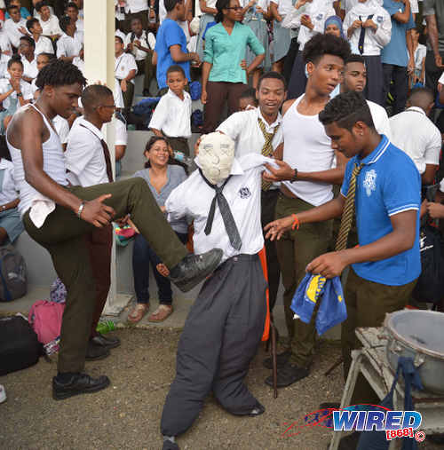 Photo: Presentation College (San Fernando) supporters make a bobolee out of a Naparima College effigy in the stands. But their players could not do the same on the field, as they lost 2-0 in SSFL Premier Division action at Lewis Street, San Fernando on 28 September 2016. (Courtesy Wired868)