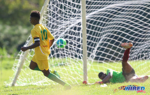 Photo: Signal Hill Secondary captain Akil Frank (left) peels off to celebrate after beating East Mucurapo Secondary goalkeeper Joshua Davis during SSFL Premier Division action at Moka on 14 September 2016. Signal Hill won 2-1. (Courtesy Sean Morrison/Wired868)