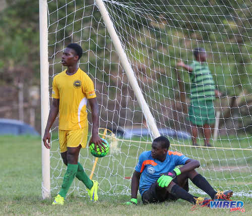 Photo: Signal Hill goalkeeper Joshua James (right) looks dejected while his defender removes the ball after a controversial penalty kick by East Mucurapo during SSFL Premier Division action at Moka on 14 September 2016. Signal Hill won 2-1. (Courtesy Sean Morrison/Wired868)