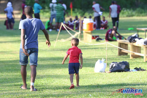 Photo: We dem boys! Two patrons take a stroll during halftime of a SSFL Premier Division fixture between East Mucurapo and Signal Hill at Moka on 14 September 2016. (Courtesy Sean Morrison/Wired868)