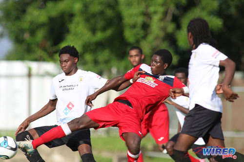Photo: St Anthony's College attacker Kathon St Hillaire (left) holds off Fyzabad Secondary midfielder Kaylon Padilla (centre) during SSFL Premier Division action on 24 September 2016 at Fyzabad. (Courtesy Chevaughn Christopher/Wired868)