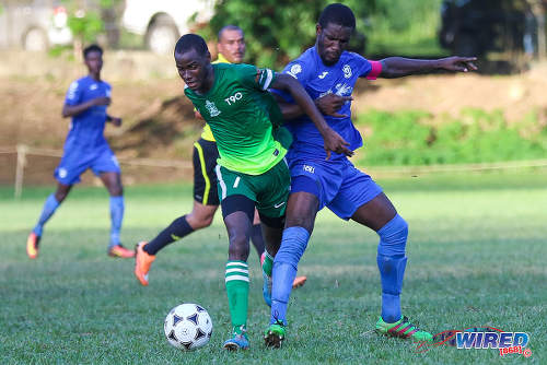 Photo: Trinity College midfielder Saleem Henry (left) tries to hold off Naparima College captain Shane Sandy during SSFL Premier Division action on 21 September 2016 at Moka. (Courtesy Sean Morrison/Wired868)