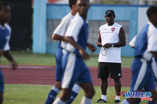 Photo: Trinidad and Tobago National Under-17 Team coach Russell Latapy (background) looks on at a national training session. (Courtesy Chevaughn Christopher/Wired868)