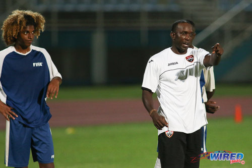 Photo: Former Trinidad and Tobago 2006 World Cup captain and Manchester United star Dwight Yorke (right) gives instructions to National Under-17 midfielder Luke Singh at a training session. (Courtesy Chevaughn Christopher/Wired868)