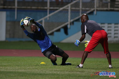 Photo: Trinidad and Tobago National Under-17 Team Elijah Shade (left) is prepared by goalkeeper coach Nigel Neverson. (Courtesy Chevaughn Christopher/Wired868)