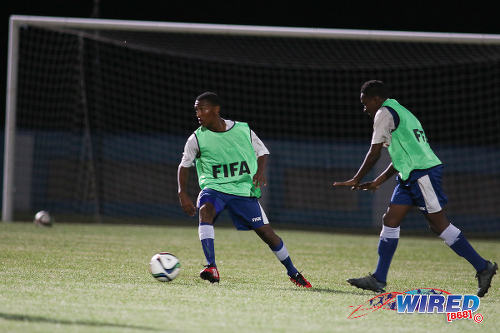 Photo: Trinidad and Tobago National Under-17 Team captain John-Paul Rochford (left) trains with a teammate. (Courtesy Chevaughn Christopher/Wired868)
