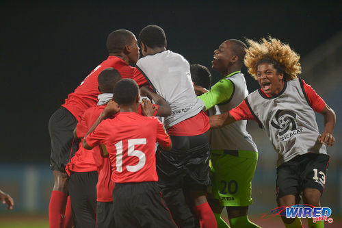 Photo: Trinidad and Tobago National Under-17 Team substitute Luke Singh (far right) joins in the celebrations after their 3-2 comeback win over Bermuda in 2017 World Cup qualifying action at the Ato Boldon Stadium, Couva on 18 September 2016. (Courtesy Chevaughn Christopher/Wired868)
