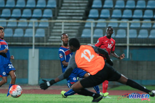 Photo: Trinidad and Tobago National Under-17 Team winger Nickel Orr (right) whips a low cross past Bermuda goalkeeper Quinaceo Hunt during 2017 World Cup qualifying action at the Ato Boldon Stadium on 18 September 2016. (Courtesy Chevaughn Christopher/Wired868)