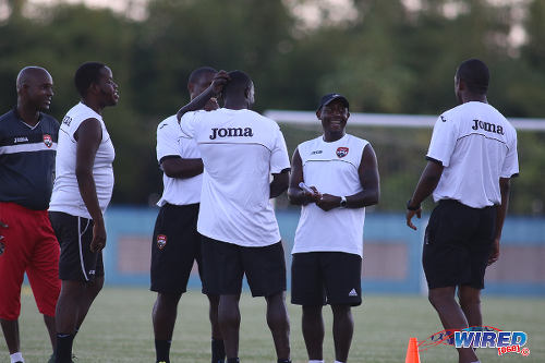 Photo: Trinidad and Tobago National Under-17 Team head coach Russell Latapy (second from right) has a laugh with his technical staff before practice in Couva. (Courtesy Chevaughn Christopher/Wired868)