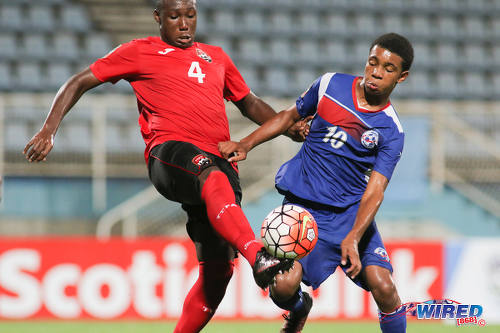 Photo: Bermuda attacking midfielder Kane Crichlow (right) pressures Trinidad and Tobago defender Tyrique Andrews during 2017 Under-17 World Cup qualifying action at the Ato Boldon Stadium on 18 September 2016. (Courtesy Chevaughn Christopher/Wired868)