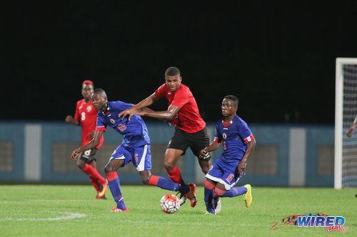 Photo: Trinidad and Tobago substitute Jaydon Prowell (centre) tries to get past Haiti midfielders Obenson Laveille (left) and Jean Danley during 2017 Under-17 World Cup qualifying action in Couva on 17 September 2016. Haiti won 2-0. (Courtesy Chevaughn Christopher/Wired868)