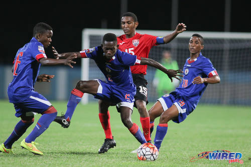 Photo: Trinidad and Tobago midfielder John-Paul Rochford (centre) is closed down by the Haiti trio of (from left) Obenson Laveille, Jolicoeur Etienne and Marc Martine during 2017 Under-17 World Cup qualifying action in Couva on 17 September 2016. Haiti won 2-0. (Courtesy Chevaughn Christopher/Wired868)