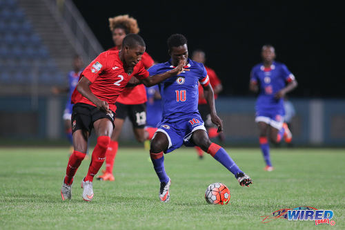 Photo: Haiti star Steeve Saint Duc (right) tries to take the ball past Trinidad and Tobago right back Kerdell Sween during 2017 Under-17 World Cup qualifying action in Couva on 17 September 2016. Saint Duc scored once as Haiti won 2-0. (Courtesy Chevaughn Christopher/Wired868)